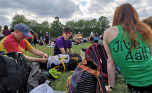 Members of Jive4All sitting and relaxing on the grass at Big Weekend festival 2019