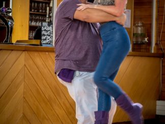 Angela Stewart Armstrong dancing with her partner